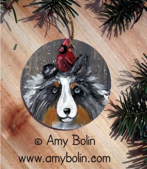"""Winter Buddies2"" Blue Merle Shetland Sheepdog & Cardinal Ceramic Ornament Round"