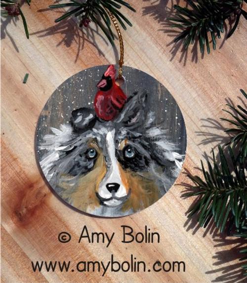 """Winter Buddies"" Blue Merle Shetland Sheepdog & Cardinal Ceramic Ornament Round"