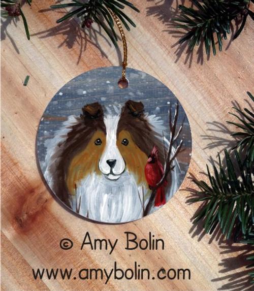 """Winter Buddies"" Sable Shetland Sheepdog & Cardinal Ceramic Ornament Round"