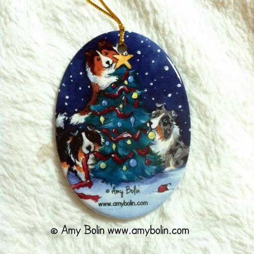 """Christmas Together"" Blue Merle, Sable & Tri Color Shetland Sheepdog Ceramic Ornament Oval"