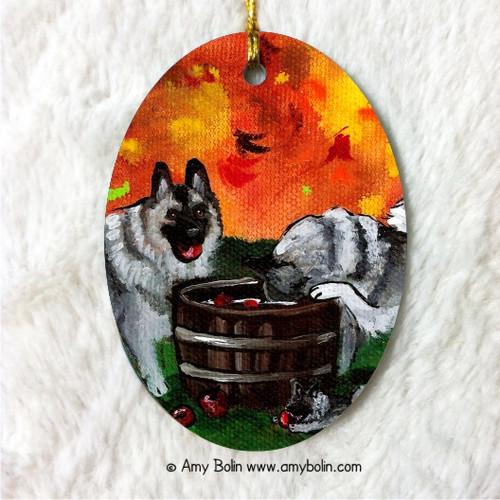 """Bobbing For Apples"" Norwegian Elkhound Ceramic Ornament Oval"