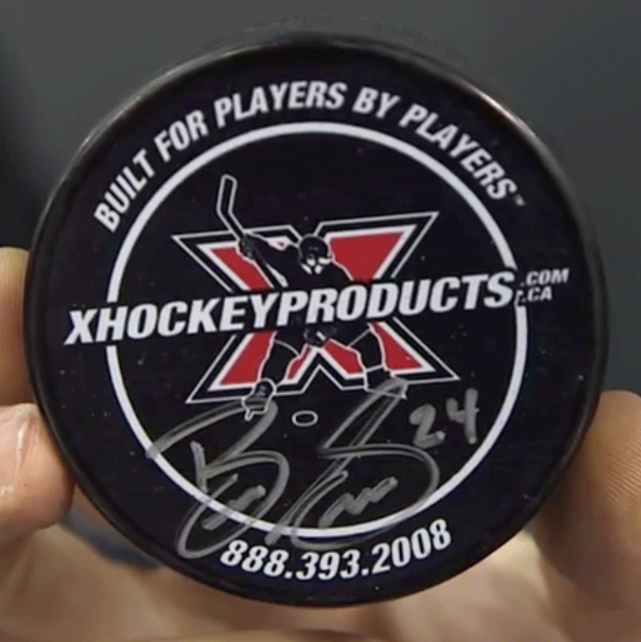 Autographed xHockeyProducts Puck