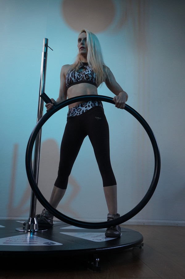 """An in-house test was carried out with Julie Fox from Hell on Heelz.  See her comments below  """"I absolutely loved using the Lollipop Lyra. It was a fun combination of both Pole and Lyra. As a frequent user of freestanding poles I'm always aware of the 'bounce' you tend to get whilst using them, so I was surprised to experience very little wobble, if any during the testing. I also rarely put my pole on spin and so I was a little nervous at first, but the design and quality of the product meant these nerves soon disappeared and I did not feel like I needed any mats. My worry about spinning was also very quickly overcome as it was so much fun and so secure to use and looks more effective when on spin than static. When I did my first tentative special K in the hoop I was surprised (but very pleased) that there was very little flex on the pole.  Things I might change, to be honest there isn't much here. Potentially I might decrease the thickness of the hoop, the thickness currently means it is very comfortable to use and sit on but, I think hand grip would be increased if it were 5mm or so smaller. (However, I didn't really struggle with grip and was happily dead lifting on it as it was)"""