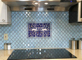 Behind stove with blue field tiles