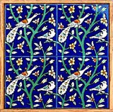 Peacocks and birds in tree, cobalt blue wood framed wall hanging