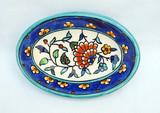 Oval dish with an elegant carnation design, with dark blue rim