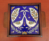Two peacocks tile in a tray