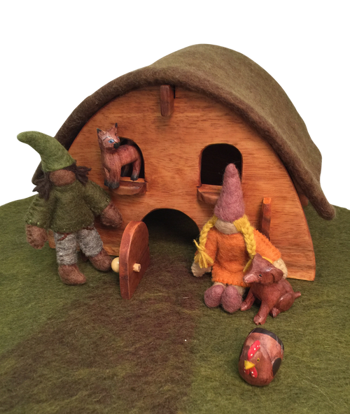 The gnome house set include the gnome house with roof, a wooden hand carved dog, cat and chicken and two gnomes and the play mat it sits on.
