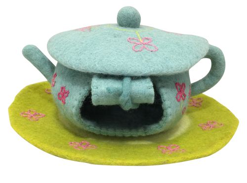 A sweet fairy house in the shape of a teapot.