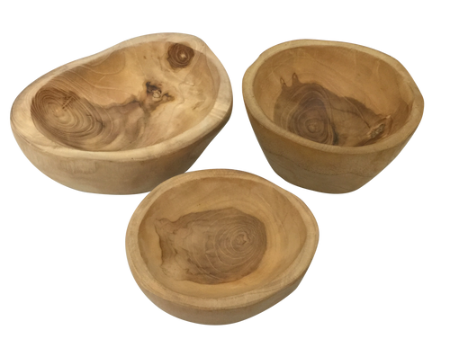 A set of 3 teak bowls, each one different. Made from waste material from the furniture industry.