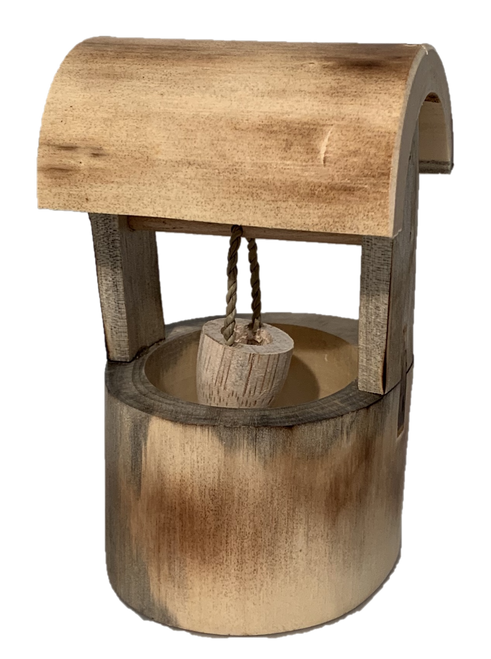 A sweet little wishing well hand made from wood.