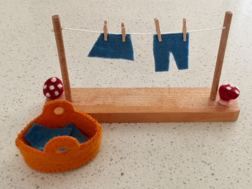 Washing Line set includes de-mountable washing line, basket, 4 clothes shapes and 4 mini pegs.
