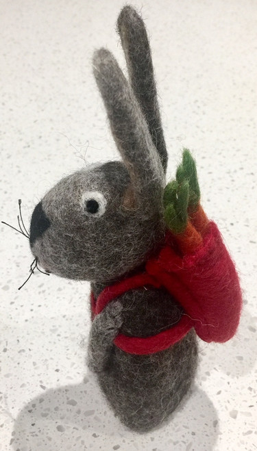 This hollow bunny stands very well. You can also use it as large finger puppet.
