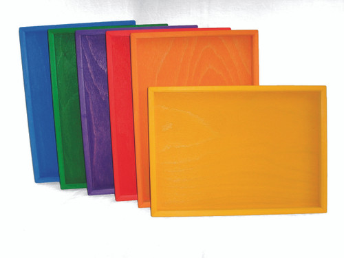 Six wooden trays in bright colours matching the rest of the Bauspiel range.