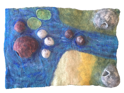 The Estuary Mat has a cave in the water for shelter for fish, mermaids... and 2 caves on land for small critters.  The 3D features of this mat make it a delightful small world play experience  The mat is roughly 60x90cm. As these are all hand felted small variations in design and size occur and are a feature of our products.