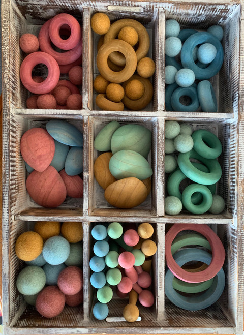 Another tray in the EARTH range, filled with open ended goodies for hours of play. This tray holds Doughnuts, Wood Rings, Pebbles and felt balls in 2 sizes, 3.5 and 5cm.