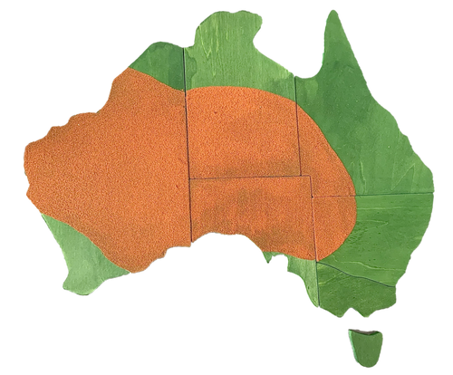 Map of Australia Puzzle/7pc. Made from 10mm ply, hand-painted with compliant dyes in our Melbourne workshop. Red sand glued on to represent the red centre.