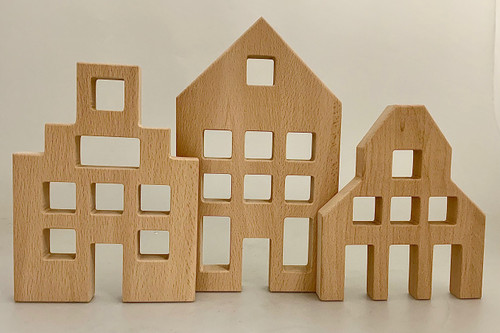 The Houses are 17.5, 20 and 25cm high. Our new, soon to come, Lucite blocks will be able to fit in the window and door spaces. Also the Bauspiel cubes will be a perfect fit. Made from all natural Beech Wood. Sold as a set of 3