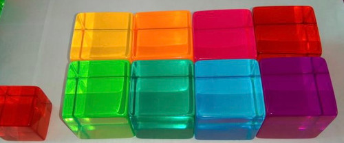 The Phatt Cubes shown here are only 8 of the 10 colours; black and clear are missing form the image. The small cube on the left is the regular 2.5cm size.