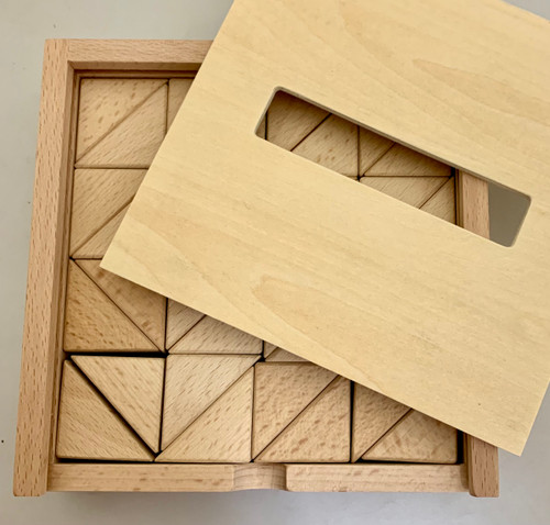 Waiting for the correct image, these are the small triangles: the large ones are packed the same way and have 24 pieces