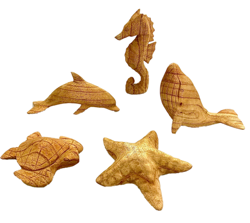 A hand carved Sea Horse, Dolphin, Whale, Turtle and Sea Star.