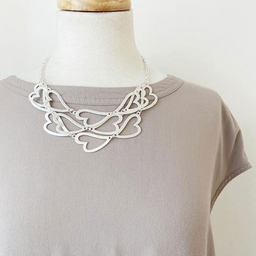 Collier Necklace Silver Short Necklace With Worn Metal Layered Heart Shape Pieces by Caracol