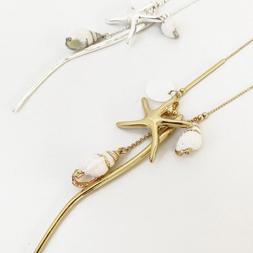 Collier Necklace Silver Long Necklace With Assorted Charms And Naturel Shells by Caracol