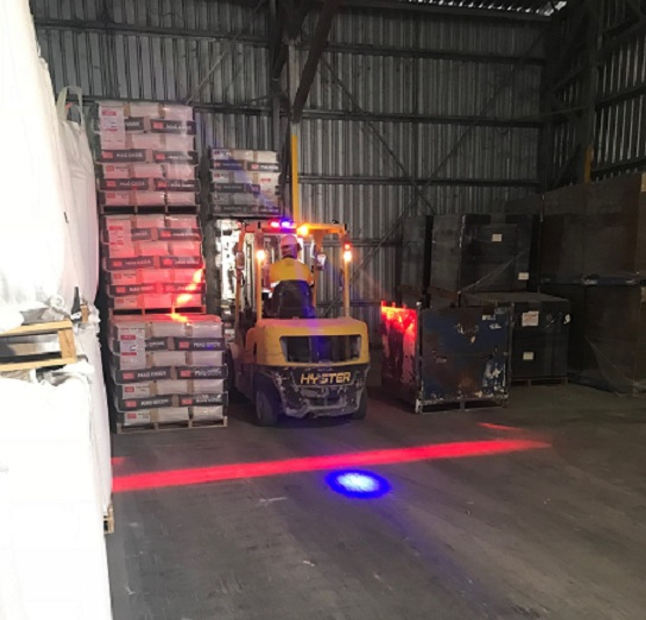 Sibelco storage warehouse in the Nth Queensland area, forklifts fitted with our Safety Halo Systems. Ultimate LED Australia
