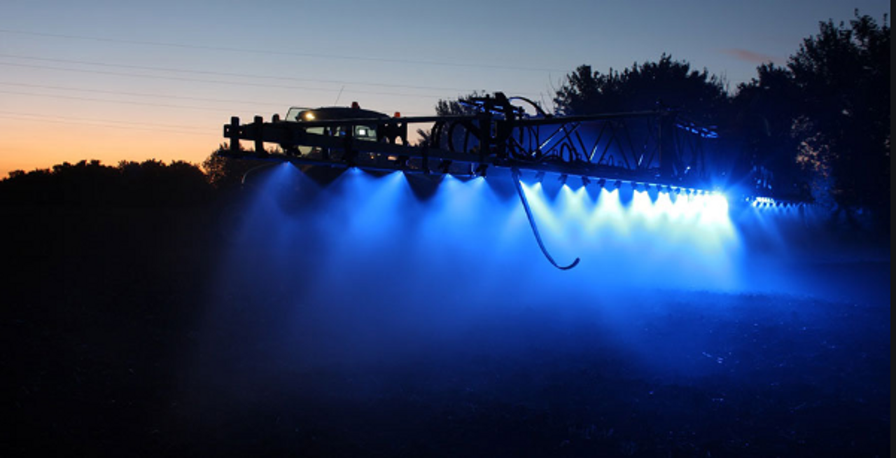 Blue Boom Spray Illumination Light. After sunset
