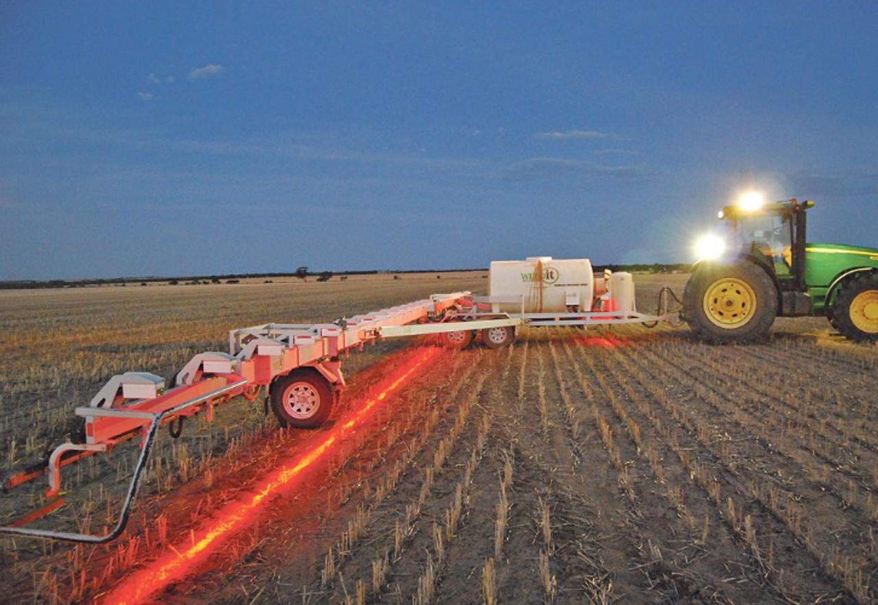 Red Boom Spray Illumination Light. After sunset