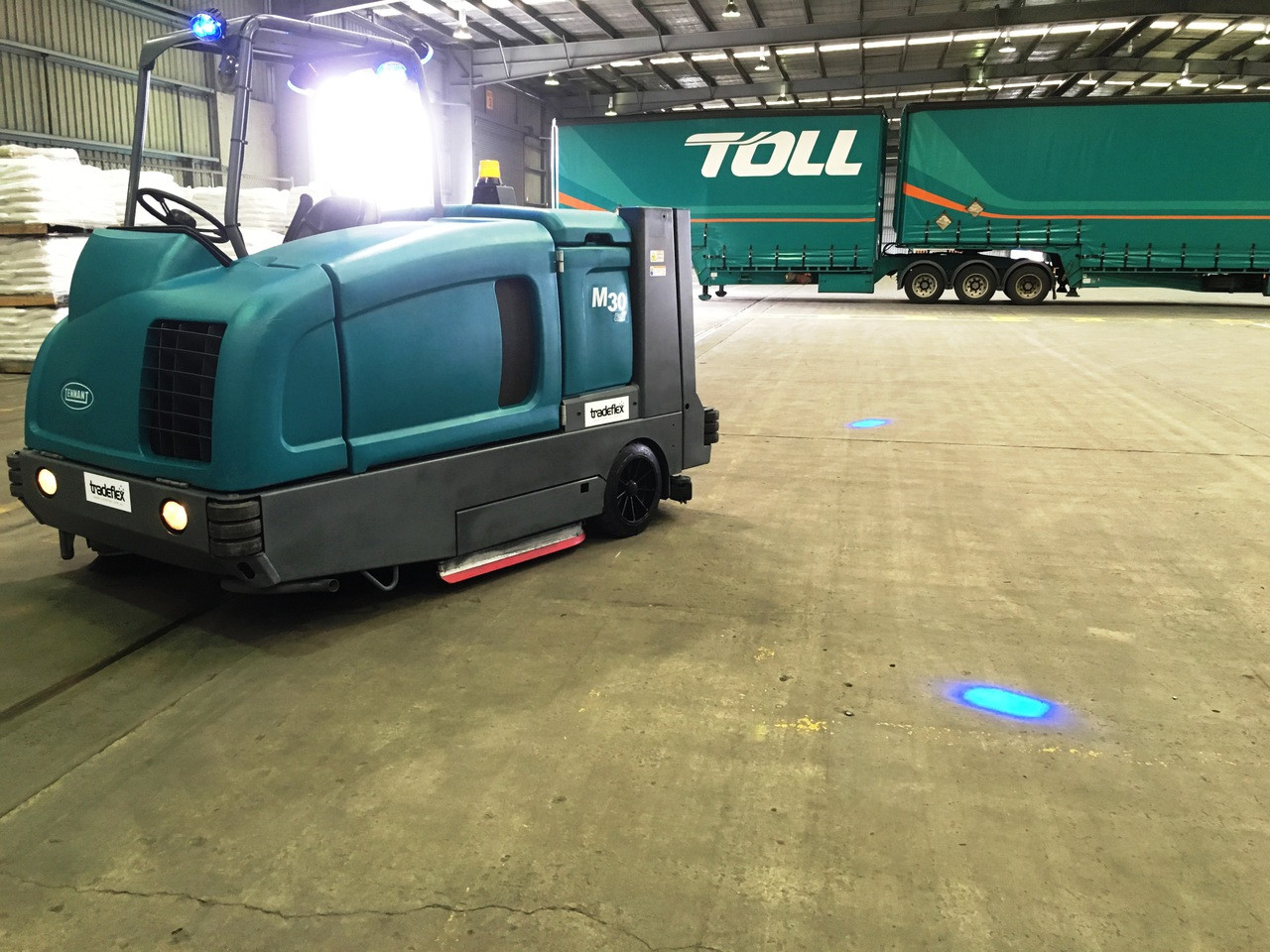 Our Blue or Red Forklift Spot light can be used in many applications. Tradeflex supplied Toll with their warehouse sweepers and fitted our Blue Forklift Warning Light. Its visual and it works. Available in Blue Red and Green
