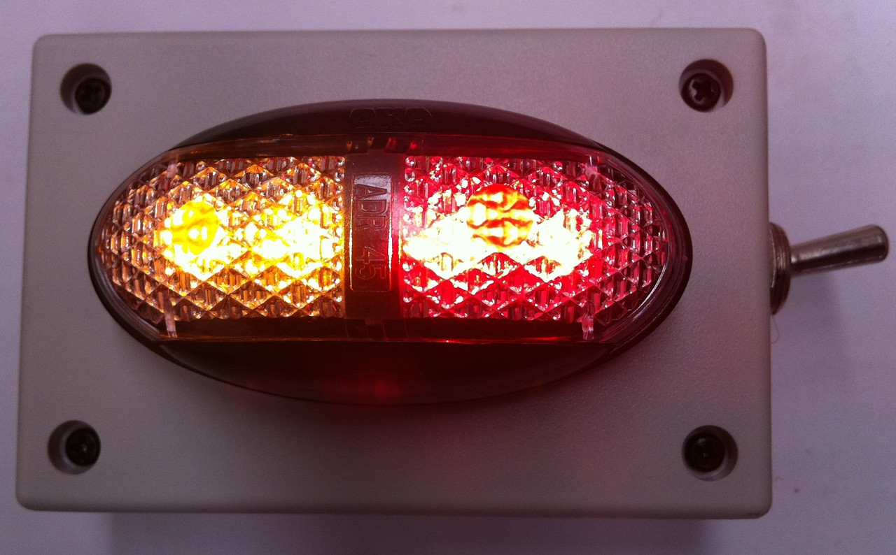 Battery Operated Amber/Red Marker Light. Oversize, Over Dimension Clearance Light. Amber Red. On Off Switch. Magnetic Mount. Wireless, Battery Operated. Picture is with the Light Operating. Light is ADR Approved. Hand made by Ultimate LED