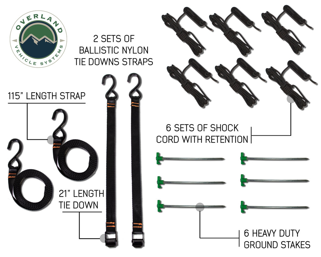 """18069909 OVS Nomadic Awning 180 - Green Cover With Black Cover Universal. 2 sets of ballistic nylon tie down straps, 6 sets of shock cord with retention, 6 heavy duty ground stakes, 115"""" length strap, and 21"""" length tie down."""