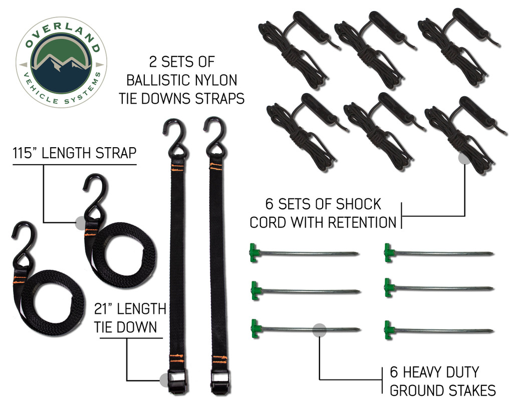 "18079909 OVS Nomadic Awning 270 - Green Cover With Black Cover Universal. 2 sets of ballistic nylon tie down straps, 6 sets of shock cord with retention, 6 heavy duty ground stakes, 115"" length strap, and 21"" length tie down."