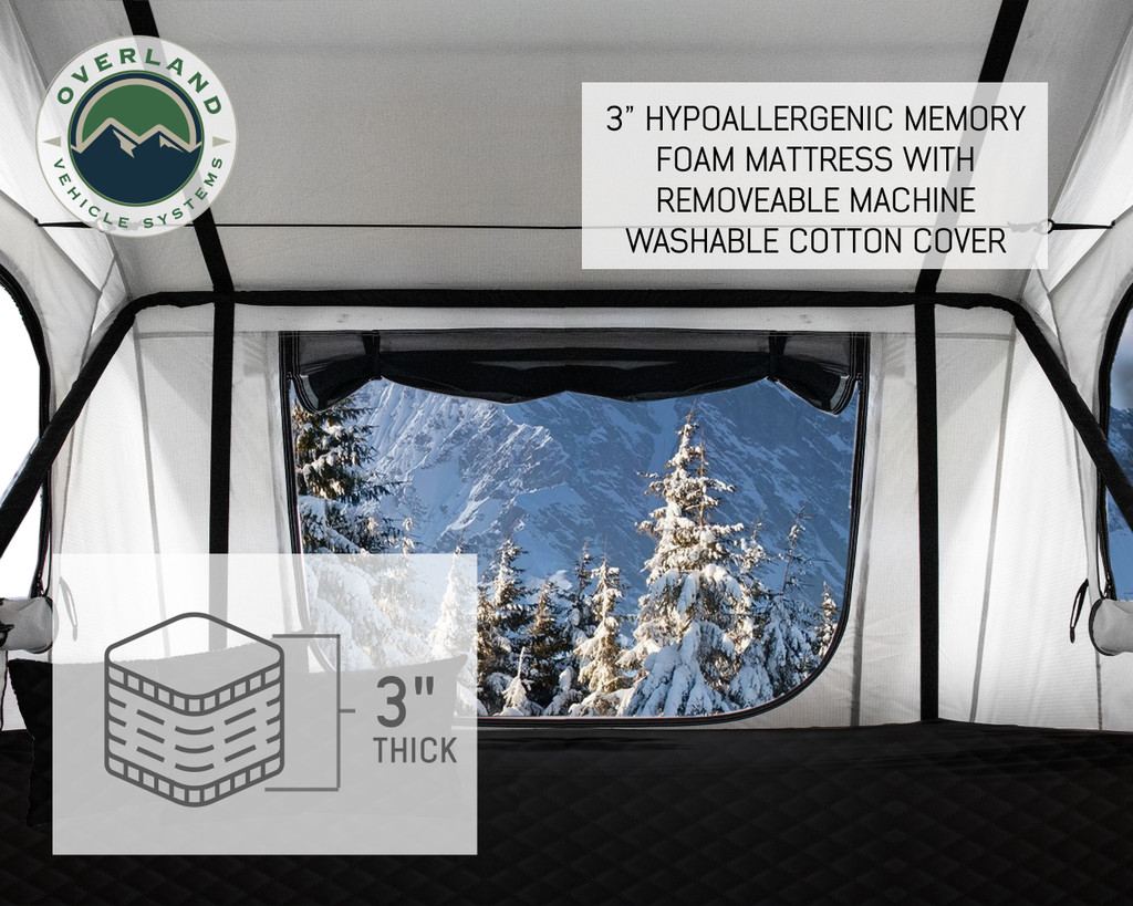 """18039926 OVS Nomadic 3 Extended Roof Top Tent - White Base With Gray Rain Fly & Black Cover Universal. Included is a 3"""" Memory Foam mattress in your Overland Vehicle Nomadic 3 Roof Top Tent.  Your Roof Top Tent memory foam mattress will allow you and others to sleep well in your Overland Vehicle Systems Roof Top Tent.truck bed tent, rooftop tent, truck tent, roof top tent, vehicle tents rooftop tent, overland vehicle systems, roof tent, truck camper tent, roof tent for truck, rooftop tents, jeep gladiator accessories, rooftop tent hard shell, roof rack, roof top tents, truck accessories, suv tents for camping, roof top tent camping, truck bed accessories, truck tents for camping, toyota tacoma accessories, car tent, roof rack awning, rooftop tents for camping, truck bed & tailgate bed tents, overlanding gear, car awning, roof tents, truck bed tents, fj cruiser accessories, tailgate tent, tacoma tent, tent for truck, truck bed rack, bed tents, truck camping tent, bed of truck tent, overland tent, RTTroof top tent, roof top tent 4 person, roof top tent 4runner, roof top tent annex,roof top tent camper, roof top tent camping, roof top tent car, roof top tent cheap, roof top tent cvt, roof top tent diy, roof top tent for car, roof top tent for jeep wrangler, roof top tent for sale, roof top tent for subaru forester, roof top tent for Tacoma, roof top tent for truck, roof top tent hard shell, roof top tent jeep, roof top tent jeep wrangler, roof top tent on trailer, roof top tent on truck, roof top tent pop up, roof top tent rental, roof top tent sale, roof top tent smittybilt, roof top tent subaru outback, roof top tent Tacoma, roof top tent tepui, roof top tent trailer, roof top tent truck, roof top tent used, roof top tent with annex"""