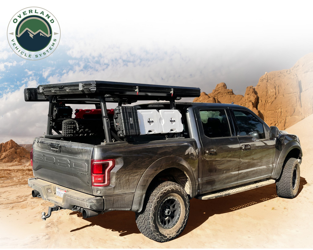 Freedom Bed Rack 3 quarter shot of a ghosted but fully loaded truck with a RTT loaded on top of the bed rack