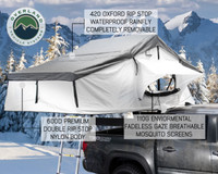 18039926 OVS Nomadic 3 Extended Roof Top Tent - White Base With Gray Rain Fly & Black Cover Universal. 420 oxford rip stop waterproof rain fly completely removable, 600D premium double rip stop nylon body, and 100G environmental fade-less gaze breathable mosquito screens. Included with your Overland Vehicle Systems Nomadic 3 Roof Top Tent is a  600D premium double rip stop nylon body, completely removable 420 oxford rip stop waterproof rain fly, and 110G environmental fade less gaze breathable mosquito screens.  The Overland Vehicle Systems Nomadic 3 RTT is built with the best materials.  truck bed tent, rooftop tent, truck tent, roof top tent, vehicle tents rooftop tent, overland vehicle systems, roof tent, truck camper tent, roof tent for truck, rooftop tents, jeep gladiator accessories, rooftop tent hard shell, roof rack, roof top tents, truck accessories, suv tents for camping, roof top tent camping, truck bed accessories, truck tents for camping, toyota tacoma accessories, car tent, roof rack awning, rooftop tents for camping, truck bed & tailgate bed tents, overlanding gear, car awning, roof tents, truck bed tents, fj cruiser accessories, tailgate tent, tacoma tent, tent for truck, truck bed rack, bed tents, truck camping tent, bed of truck tent, overland tent, RTTroof top tent, roof top tent 4 person, roof top tent 4runner, roof top tent annex,roof top tent camper, roof top tent camping, roof top tent car, roof top tent cheap, roof top tent cvt, roof top tent diy, roof top tent for car, roof top tent for jeep wrangler, roof top tent for sale, roof top tent for subaru forester, roof top tent for Tacoma, roof top tent for truck, roof top tent hard shell, roof top tent jeep, roof top tent jeep wrangler, roof top tent on trailer, roof top tent on truck, roof top tent pop up, roof top tent rental, roof top tent sale, roof top tent smittybilt, roof top tent subaru outback, roof top tent Tacoma, roof top tent tepui, roof top tent trailer, roof top tent truck, roof t