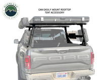 Freedom Bed Rack Rear view of the truck.  A Roof Top tent is loaded on the Freedom Rack with an awning mounted on the driver side of the vehicle.