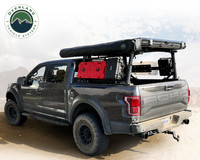 Freedom Bed Rack 3 Quarter high shot of a fully loaded rack, RTT,  gas cans, Cargo boxes and a Nomadic Awning