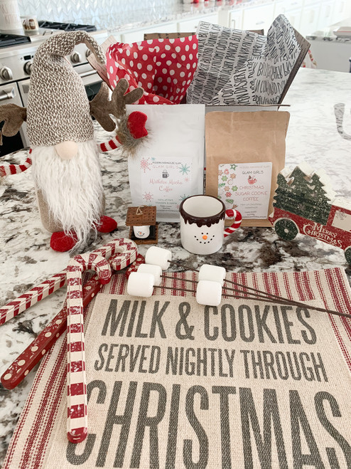 Glam Girl's Winter Box! Free Shipping! Includes 7 Holiday Gifts & 2 Bags of Glam Girls Coffees. Includes Antler Gnome, Marshmallow Pick, Smores Ornament, Snowman Mug, Milk & Cookies Towel, 3 Wooden Candy Canes, Christmas Wooden Truck, and 2 bags of Glam Girl's Ground Coffees.  (2) 12 oz bags of ground coffee, fresh premium roasted and ground beans, a Glam Girl exclusive!Pick two coffee choices: Glam Girl's Dark Roast, Glam Girl's Light Roast, Glam Girl's Pumpkin Spice, Glam Girl's Mistletoe Mocha, Glam Girl's Christmas Sugar Cookie