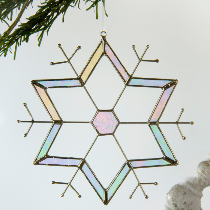 Colorful glass snowflake ornament displays brilliant color, even on the coldest days.