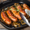 Italian style bison sausage in frying pan