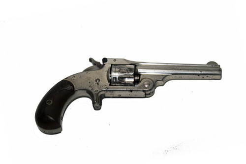 This is a Smith & Wesson 1-1/2, .32 smith & wesson centerfire revolver.
