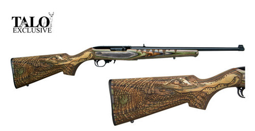 """Ruger 10/22 .22 lr (38.5"""" long with 20"""" barrel). The barrel is finished in a matte black and is equipped with a folding leaf rear sight and a gold bead front sight. This 10/22 is a special TALO edition with a Green Mountain Gator engraved on the stock."""