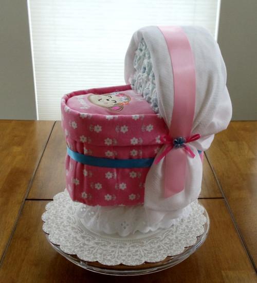 """Girl Pink/White """"Sweet like Mommy"""" Bassinet Diaper Cake."""