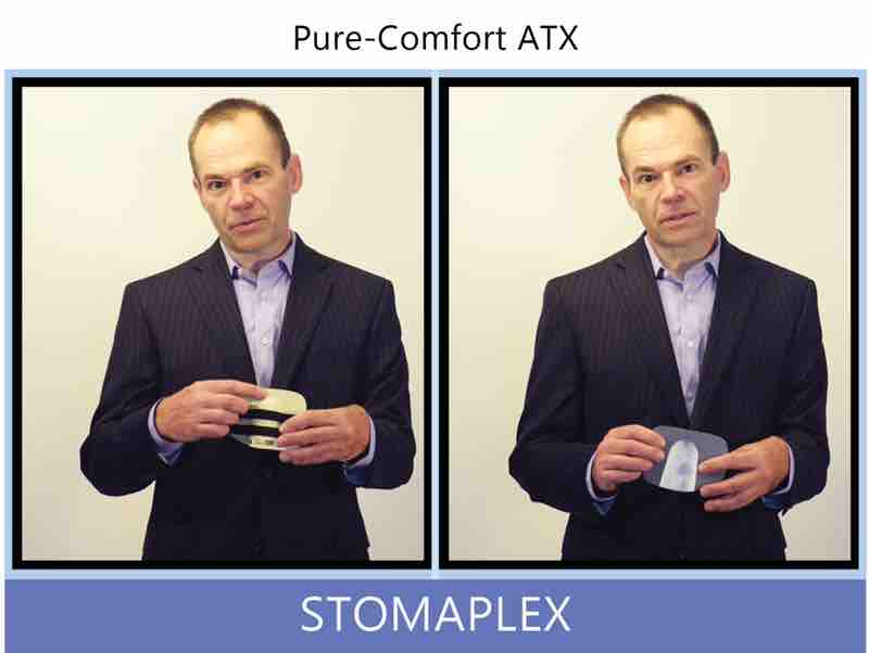 man in suit evaluates a stoma guard by stomaplex the shape allows for free flow