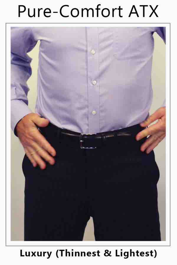 Man in purple shirt wear stoma guard inside his pants. The stoma guard allows for free flow from his ileostomy.