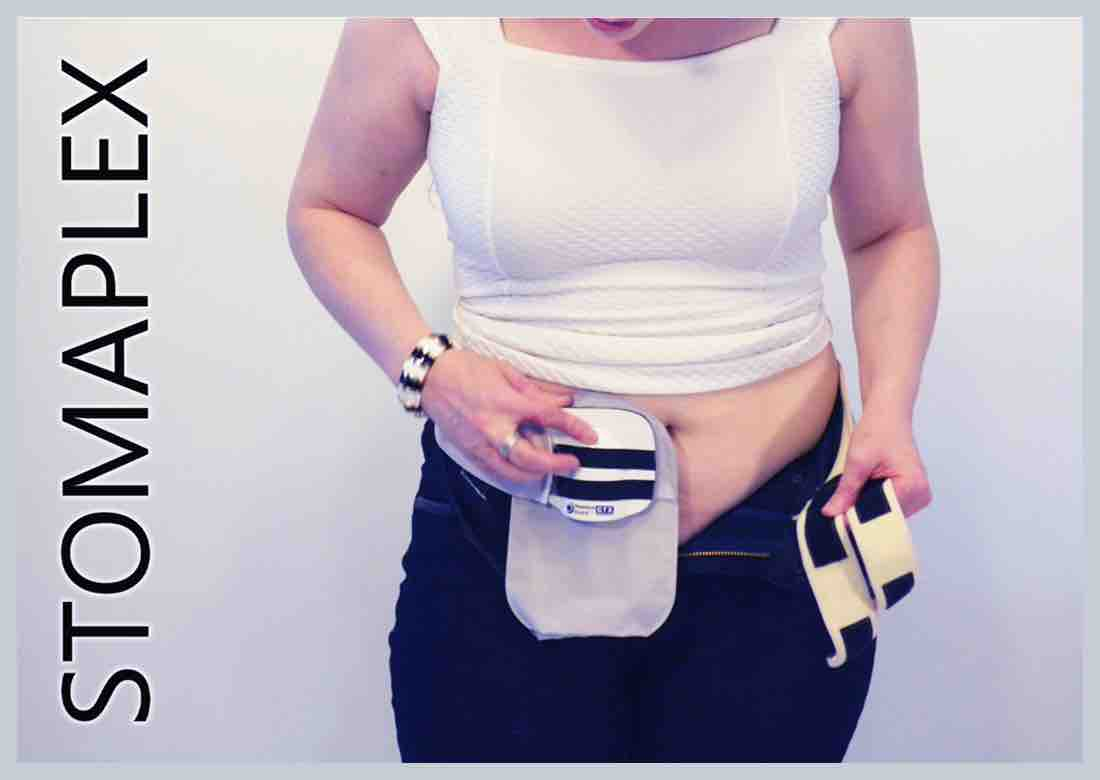 Use the belt to hold the ostomy bag of an ileostomy, made by Stomaplex stoma guard, she is showing us her ileostomy bag with her blue jeans open, ostomy protection for women