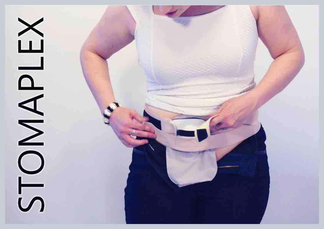 She likes the two strap design of the ostomy belt, made by Stomaplex stoma guard, with her pants unzipped she has her ostomy bag out to see, ostomy protection for blue jeans