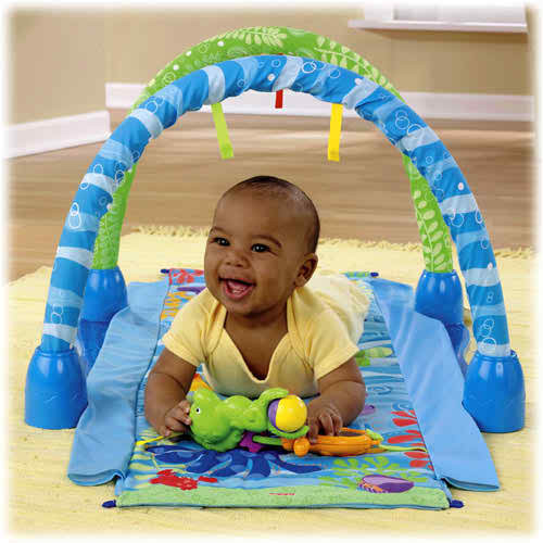 Move toys and mirror down to mat to encourage tummy-time play.